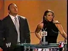Triple HHH Stephanie Mcmahon receibing an award